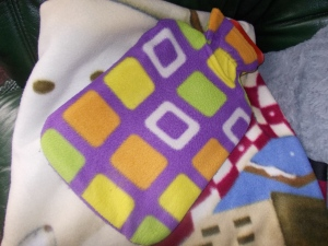 Hot water bottle and blankets to keep me warm