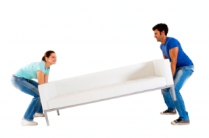 Couple Moving Sofa Stock Photo
